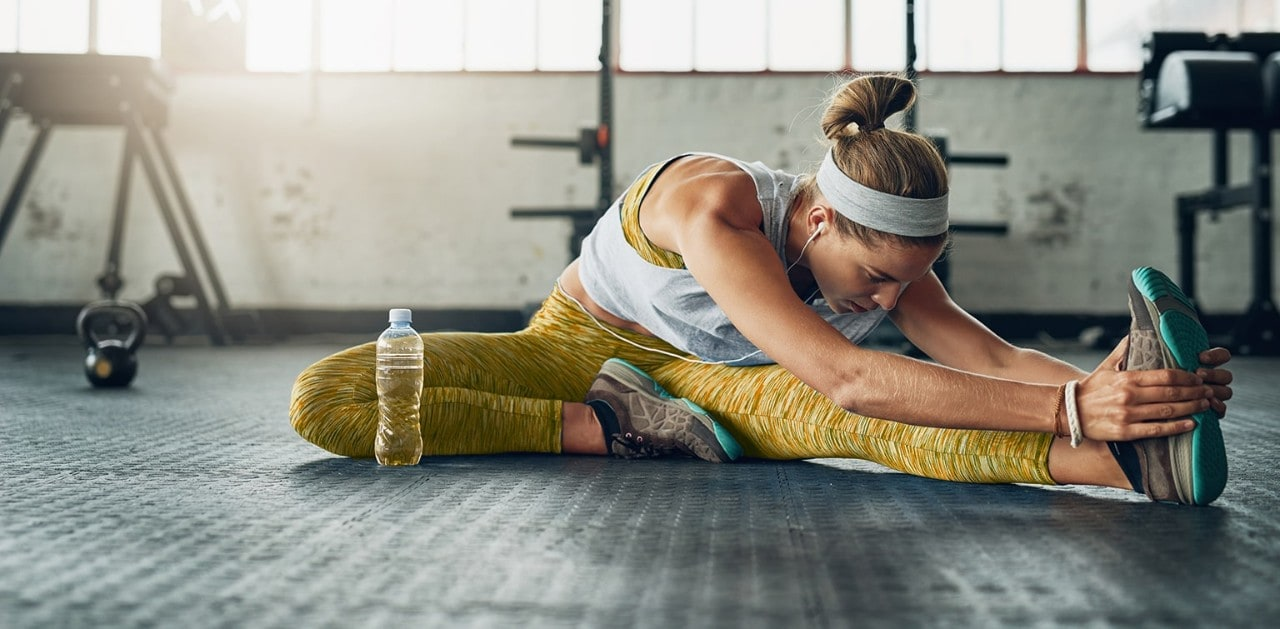 Woman stretching in gym before workout